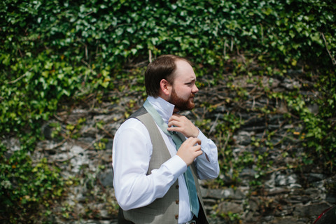 bridegroom getting ready Seaside Castle Elopement Ireland