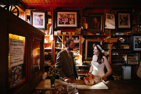 bridal couple in dick macs bar dingle with flowers