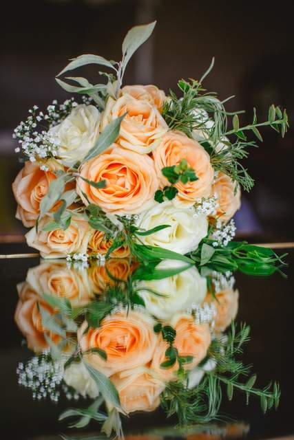 peach white and green brides bouquet
