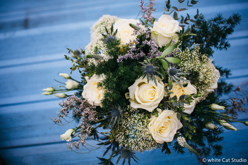 winter wedding flowers thistle white roses heather