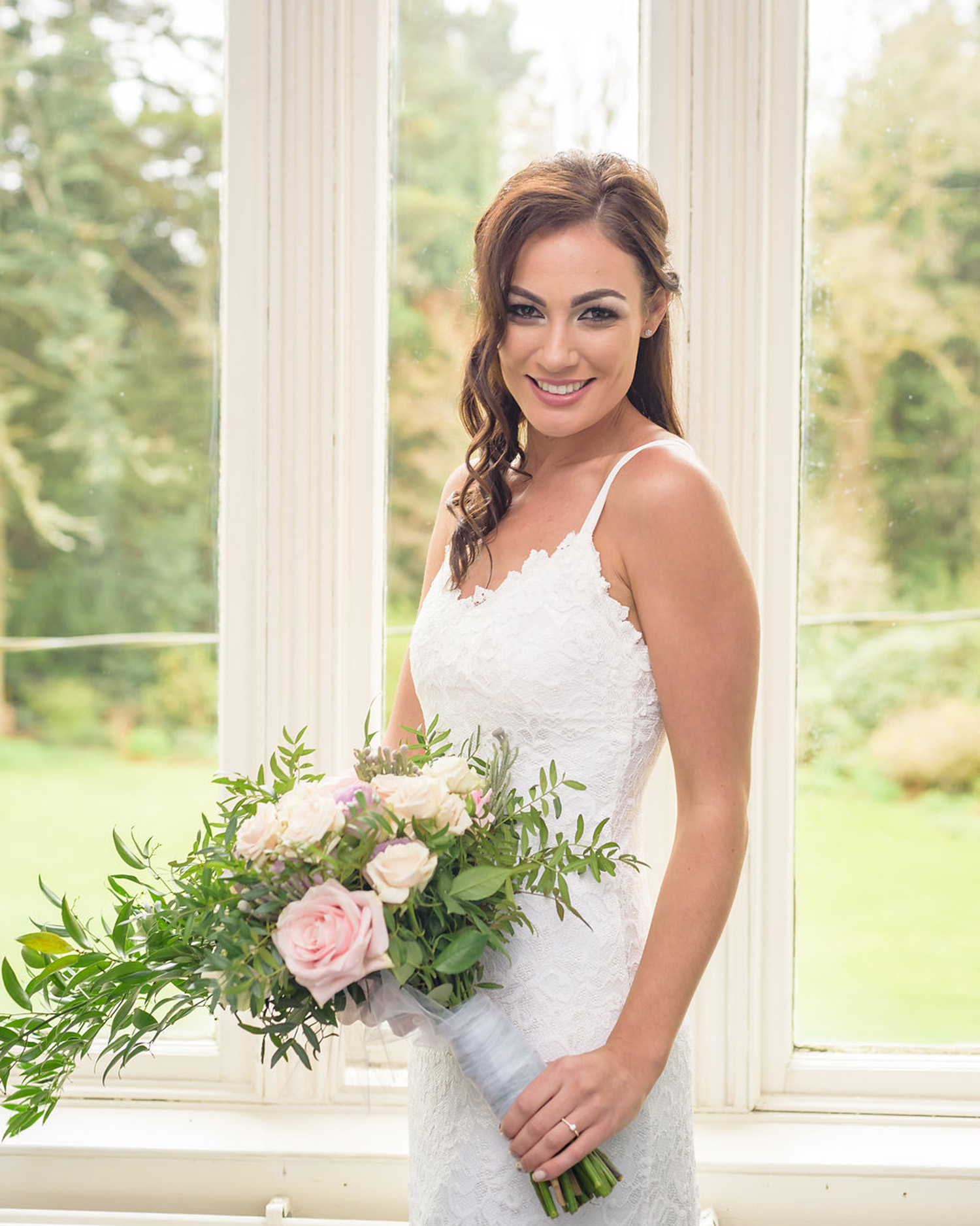 elope to ireland bride ready to get married standing with flowers A fun Elopement at an Irish Manor House Adventure