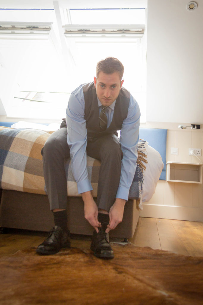 elope to ireland groom getting ready and putting on shoes