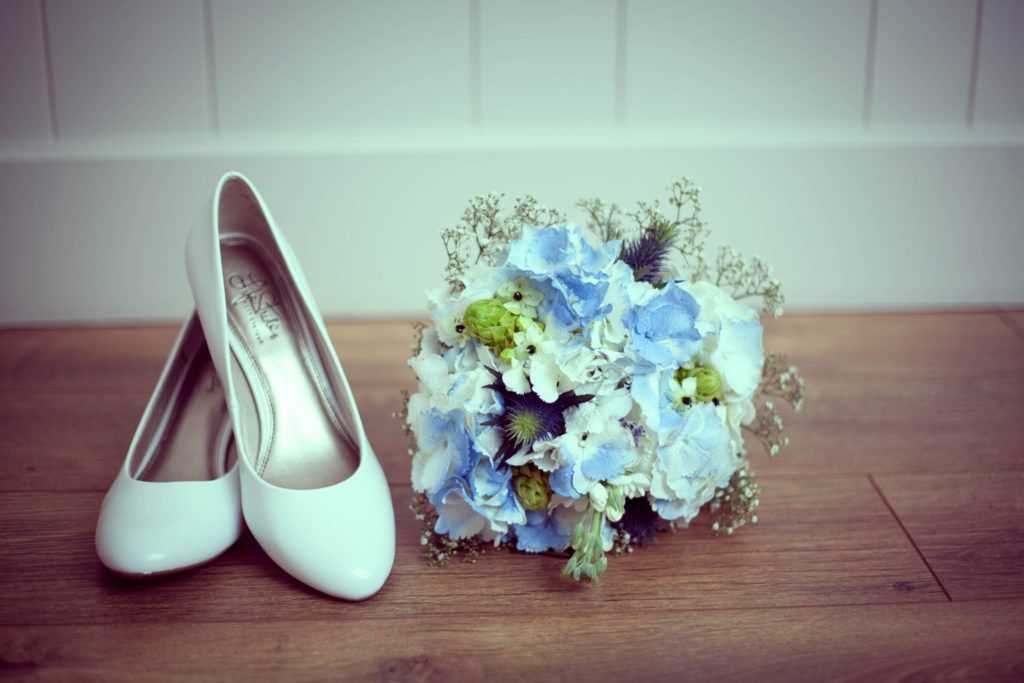 elope to ireland bouquet and shoes bride buds and blooms florist