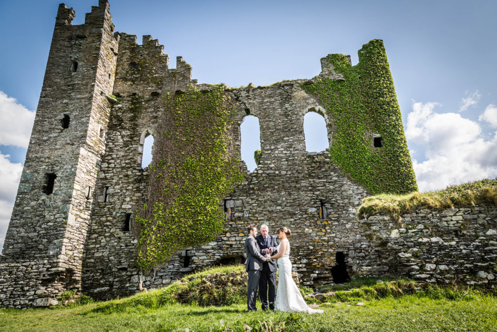 ceremony in front of Ballycarbery castle elope to ireland