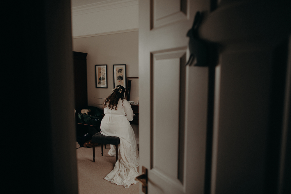 Moody Dreamy Elopement bride writing a note to groom