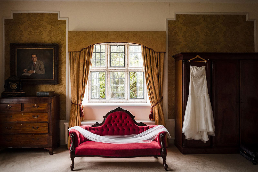 Castle elopement wedding dress on the red chaise lounge