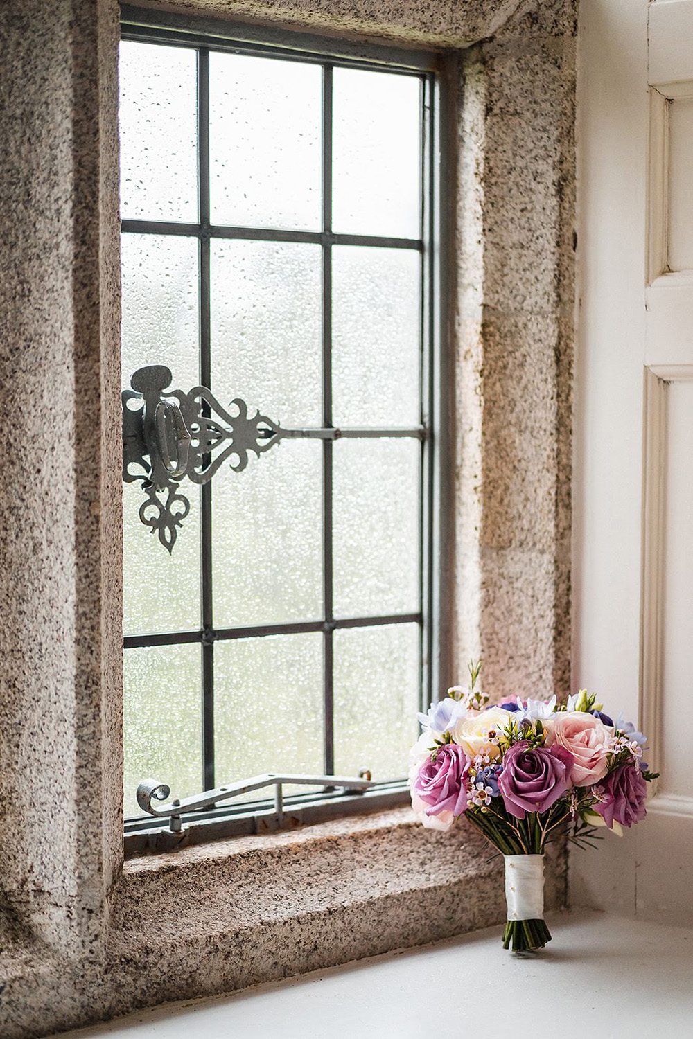 Castle elopement wedding bouquet besid the castel window