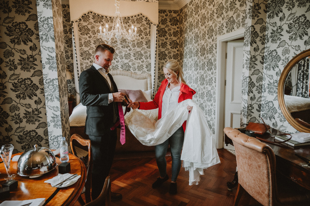 Island Elopement putting on tie and jacket