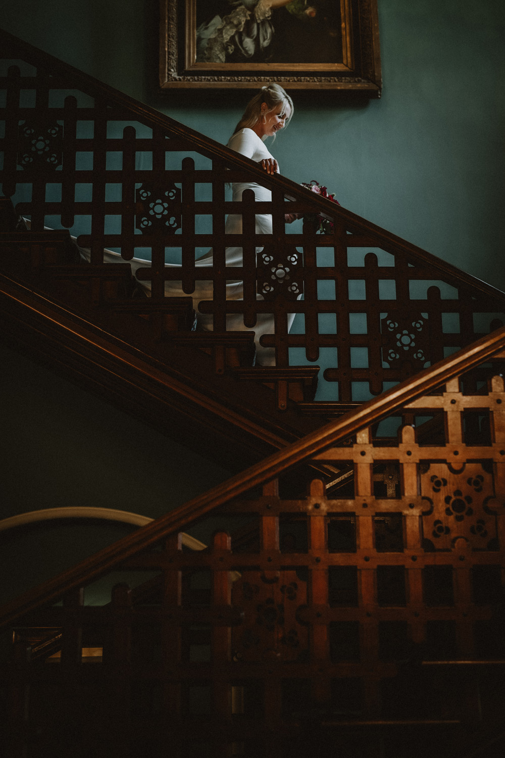 Island Elopement bride coming down stairs before first look