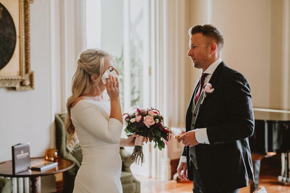island elopement bride stops makeup running crying